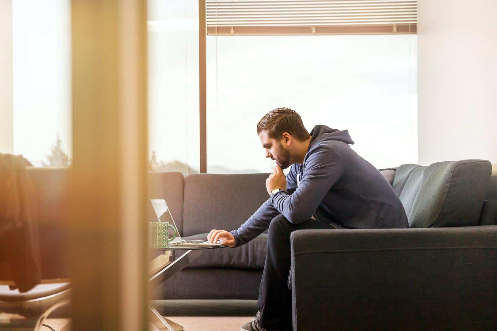 Man focused on laptop