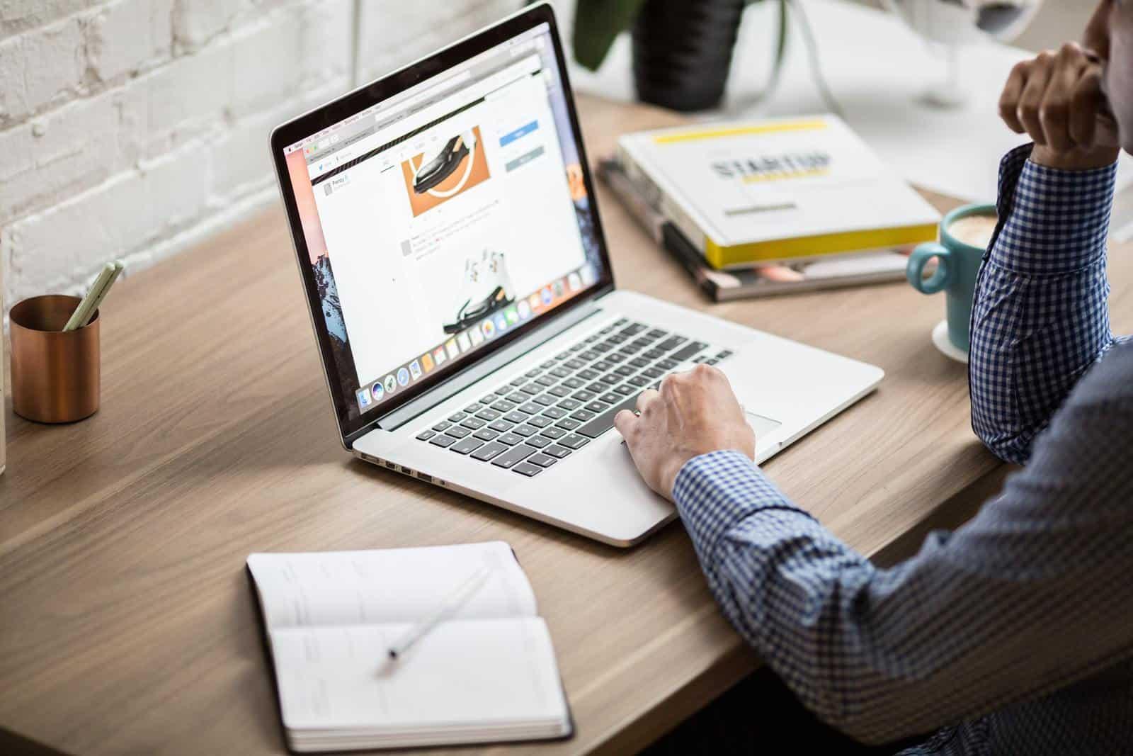 Man looking at laptop