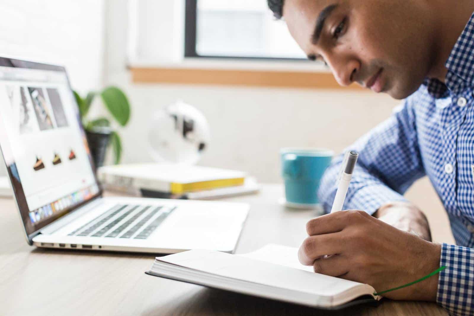Man writing things down
