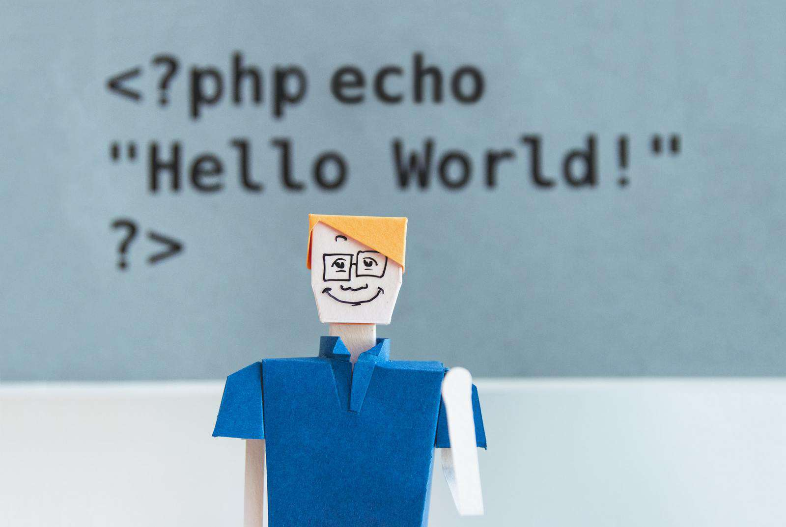 Cardboard figure in front of PHP code