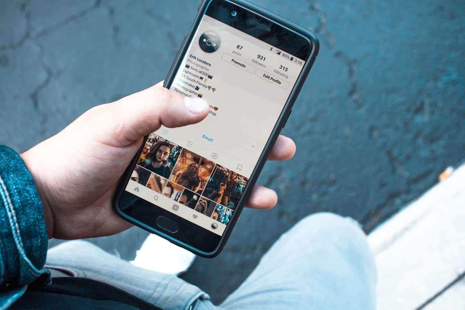 Man looking at Instagram profile