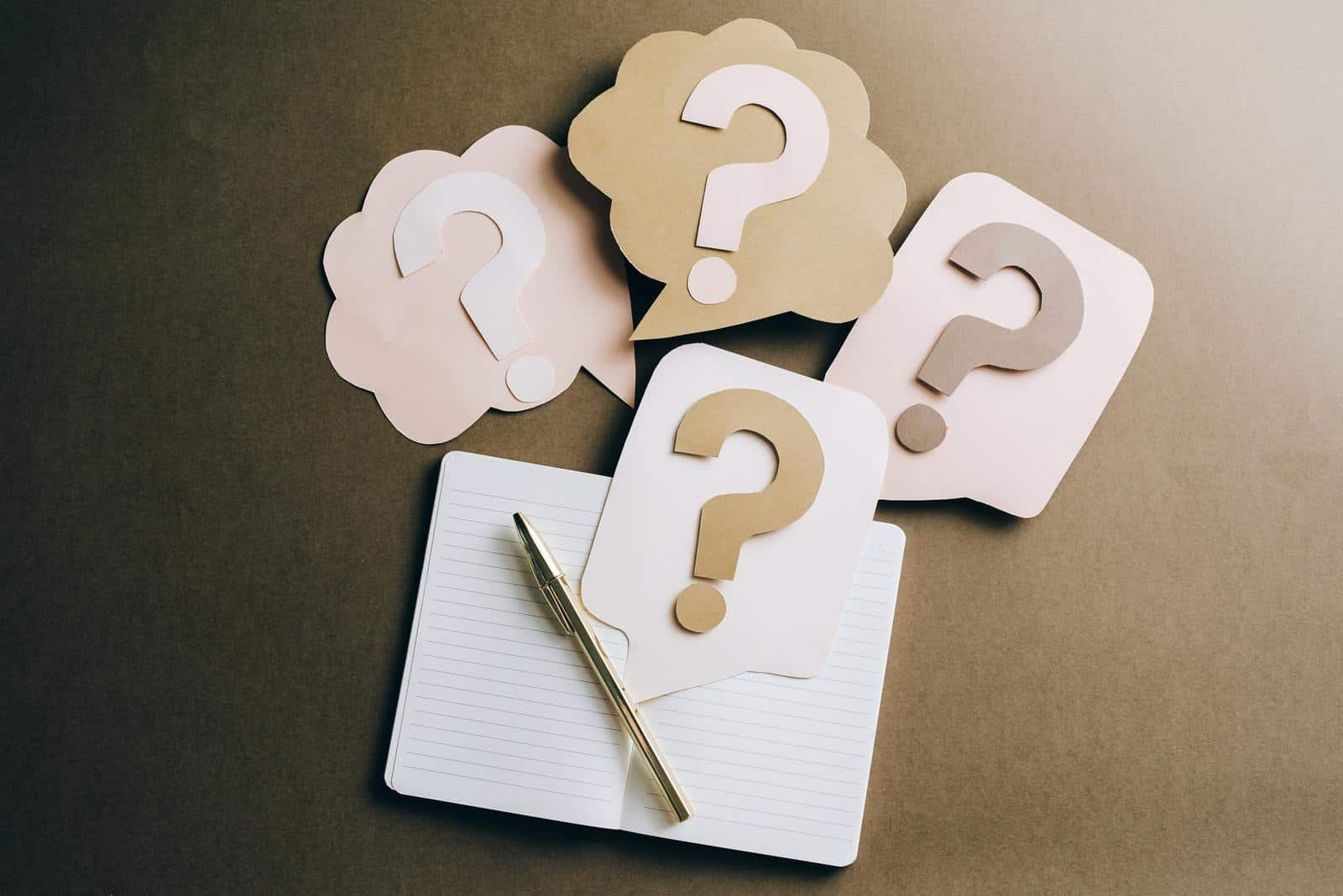 Question marks made out of cardboard